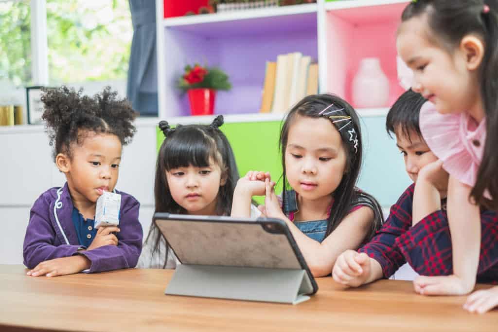 children-learning-as-group-before-COVID-19-coronovirus